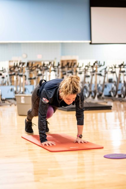 Chris Haukos, fitness instructor, teaches a class of express abs on October 28th, 2018 at St. Cloud Minn. (Photo/Chelsea Bauman)