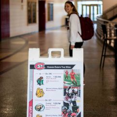 St. Cloud State University student Leah Uselmann looks back towards the sports schedule at St. Cloud. (Photo/Chelsea Bauman)