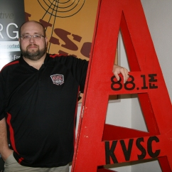 Jim Gray posing outside the front of KVSC, a student run radio station on the campus of SCSU, located in Stewart Hall, on the campus of St. Cloud State University, in St. Cloud, Minn., Wednesday, Sep. 26, 2018. (Photo/AJ Fredrickson)