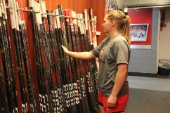 Suvi Ollikainen takes her stick in the women's hockey locker room in St. Cloud, Minn., Saturday, Nov. 17, 2018. (Photo/Janine Alder)