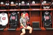 Suvi Ollikainen poses in her stall in the women's hockey locker room in St. Cloud, Minn., Saturday, Nov. 17, 2018. (Photo/Janine Alder)