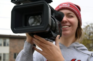 Lindsey Paulsen smiling while filming with a Panasonic 4K camera, located in St. Cloud, Minn., Tuesday, Oct. 30, 2018. (Photo/Taylor Ritenour)