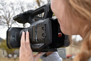 Lindsey Paulsen filming with a Panasonic 4k camera provided by the Mass Communications Department, located in St. Cloud, Minn., Tuesday, Oct. 30, 2018. (Photo/Taylor Ritenour)